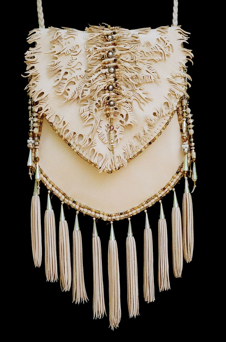 Fancy Cut Work. Deerskin and sterling silver. Made by Carole Hook.