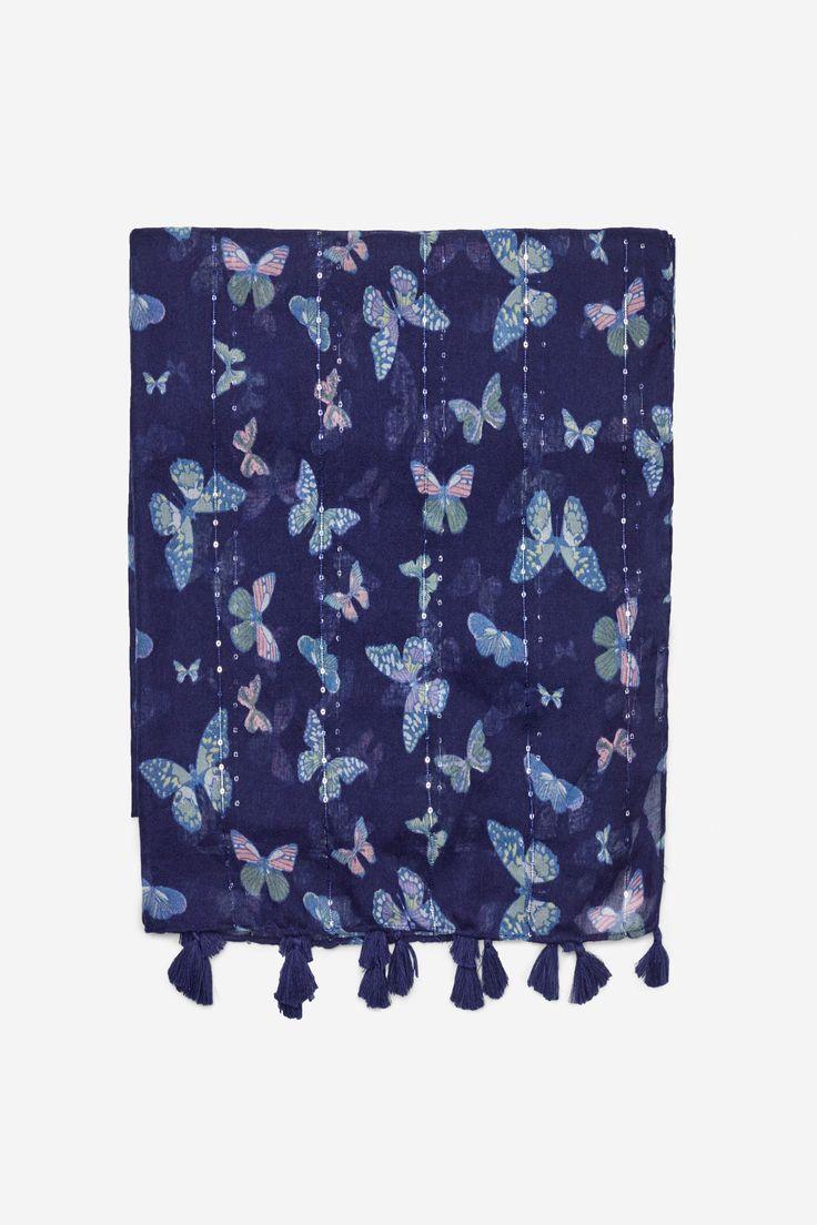 Bufanda semi ligera realizada con jacquard con dibujo y con detalle de flecos en los laterales. | Fulares | Springfield