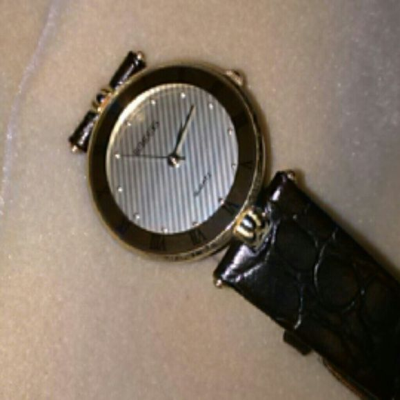 Rumours Quartz Watch Beautiful watch gold Roman numerals on face. Band is not leather and needs replacing. Rumours Jewelry