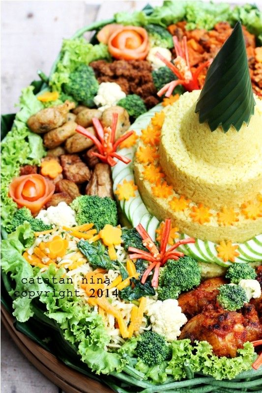 Java Indonesia food for celebration. TUMPENG NASI KUNING