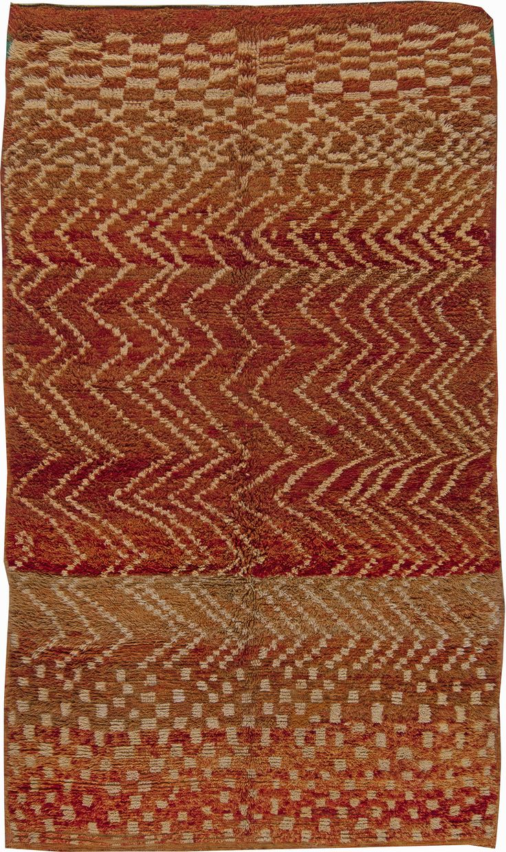Vintage Moroccan Rug, Origin: Morocco, Circa: 1940, an early 20th century vintage Moroccan Berber hand - made rug, made with hand - woven wool died with natural biological pigments, rich and deep in color and naturally simple in its pattern. The delicate checker arrangement in the shade of honey transforms into zig-zag lines to form more dense checker pattern on the opposite end of the rug. The pattern is combined with horizontal layers of different shades of clay and sand-like colors…