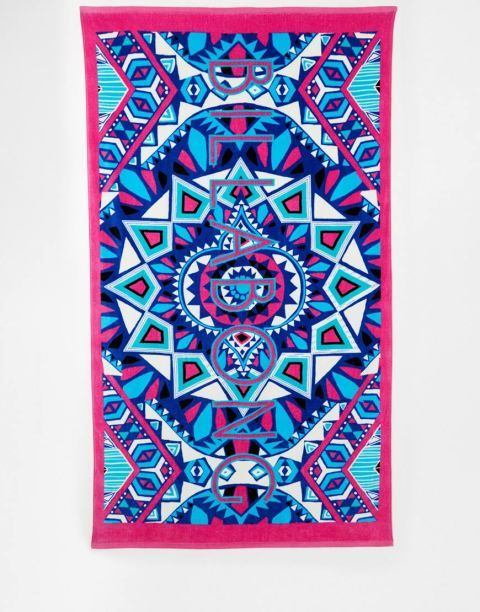 Whether you're beachside, poolside, or just hanging on your lawn or apartment's roof, add some personality to your lougne spot with a bright towel. Shop the season's 18 most colorful, including this Billabong Santiago X Large Beach Towel.
