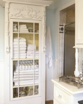 glass-front-cabinet-painted-yellow-on-the-inside-is-a-distinctive-way-to-display-towels-and-linens.jpg (287×360)