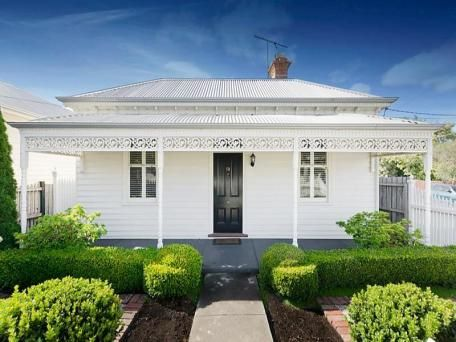 White Victorian house with black door. 68 Gertrude Street Geelong West Vic 3218