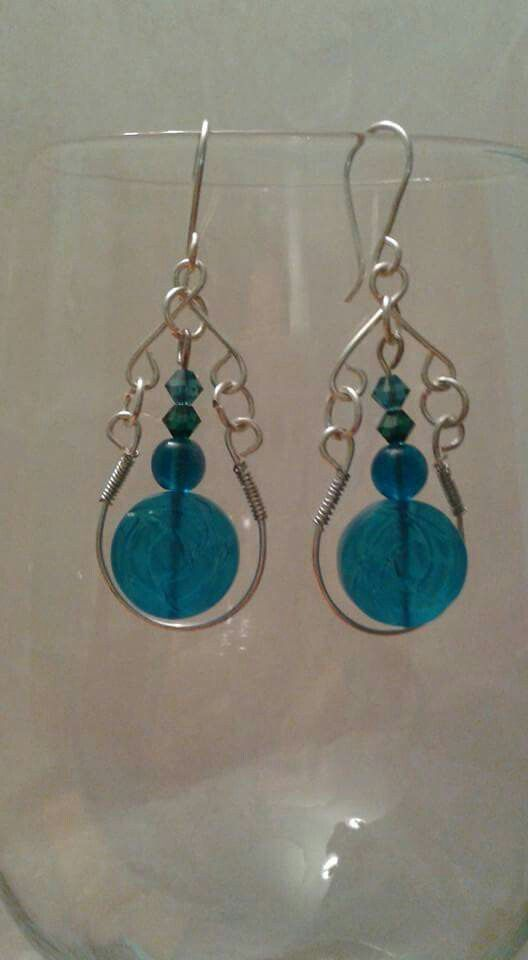 Handcrafted  wire work  earrings  made with silver  plated  wire, blue  Swarovski  Elements  Crystals  and blue beads.