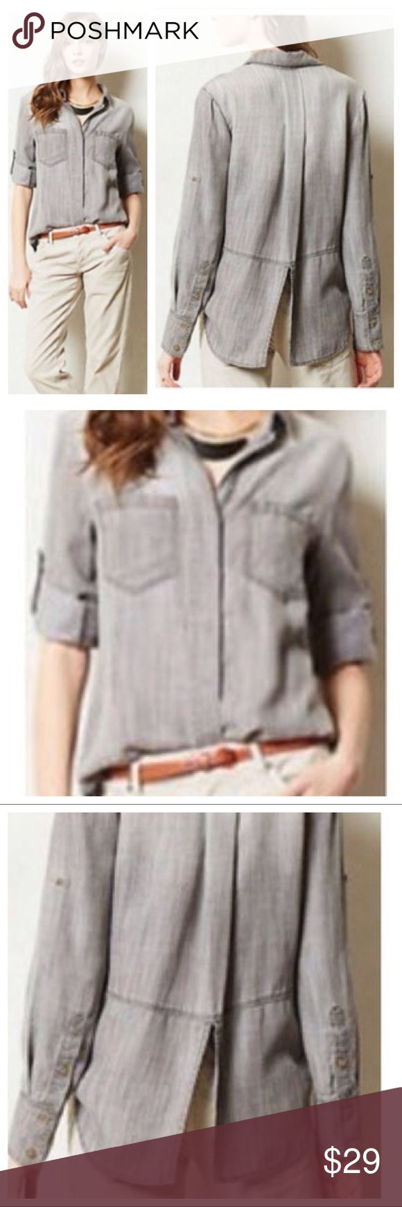 """Anthro Cloth & Stone Chambray Split Tail Shirt Anthropologie Cloth & Stone Gray Chambray Split-Tail Shirt. Material is 100% Tencel and machine washable. Two front pockets, hidden button front closure, long sleeve which can be rolled and button to 3/4 sleeves. Size Large, 18"""" arm inseam, 22"""" armpit to armpit, 25.5"""" front length, 30"""" back length. Pre-loved with little wear, no rips or stains. Anthropologie Tops Button Down Shirts"""