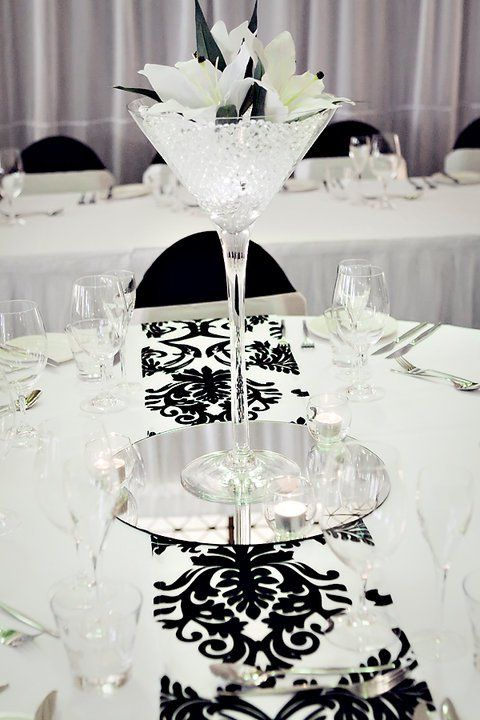 Would look so pretty with color in the glass & or colored flowers. but the black and white is so classy looking.