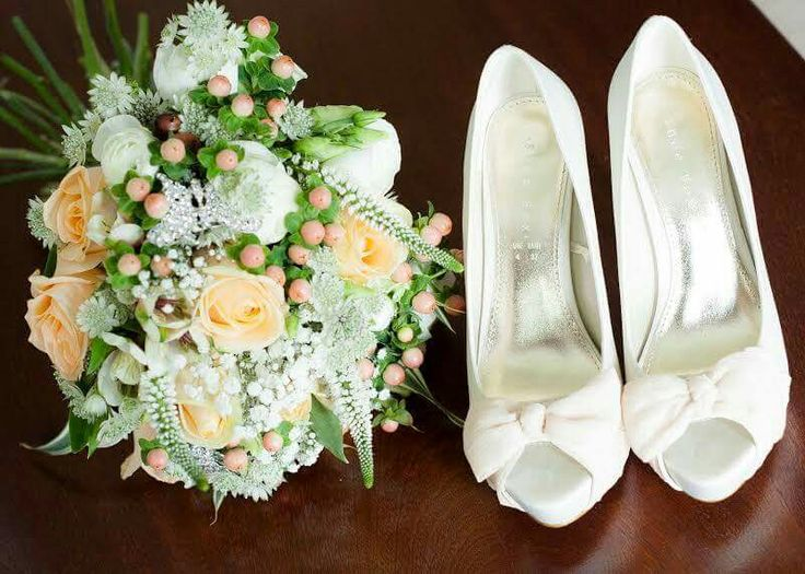 My wedding shoes and bridal bouquet.  #bridalbouquet #bridalflowers #peachflowers #peachroses #weddingshoes #butterflybrooch #peachwedding