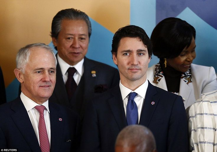 Australia's Prime Minister Malcolm Turnbull (left) stands next to Canada's Prime Minister ...