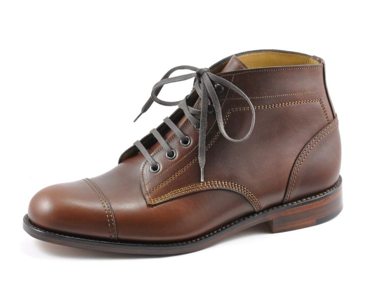 Samuel by Loake  Chunky toe cap ankle boot, made using the 'Pennine' last in a G width. Samuel features four eyelets and two ski hooks, contrast stitching, and a welted leather sole, Samuel is handmade in England.