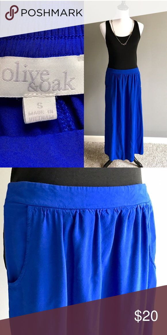 NWOT blue maxi skirt Never worn, tags removed. Blue maxi skirt. Rayon. Olive & Oak Skirts Maxi