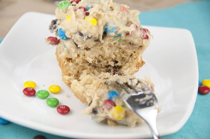 Monster Cookie Dough Cupcakes. Peanut butter cupcakes with monster cookie dough frosting
