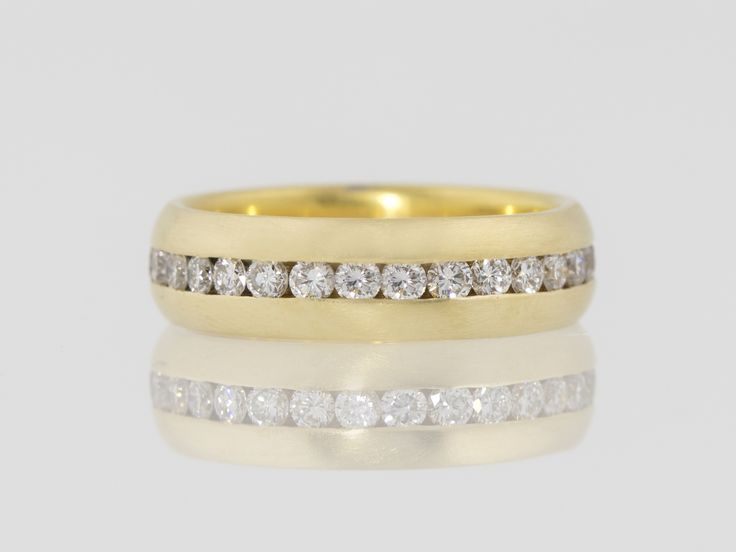Wide 18kt gold diamond eternity band with a matte finish.  Custom made at Union Street Goldsmith, San Francisco