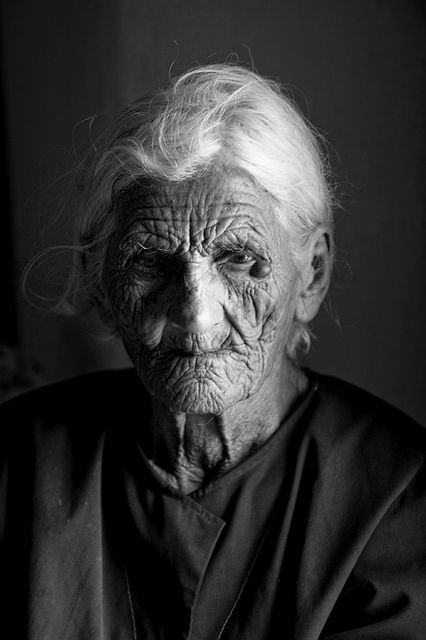A lady who has worked hard all her life....Her face has the tracks of hard work....