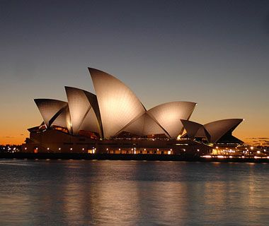 """Sydney Opera House  The monument that defines this Australian city has a roof of white concrete """"sails"""" and was completed in 1973 from designs by then-unknown architect Jørn Utzon."""
