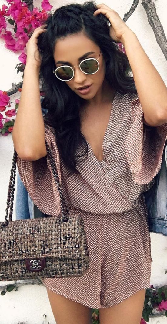 Who made Shay Mitchell's print romper and tweed handbag?