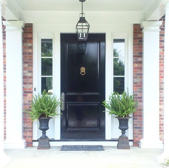 black gloss front door, matching black urns, black lantern