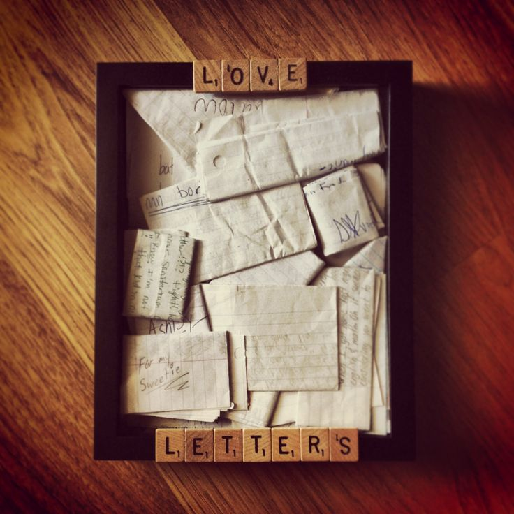 """I used a shadow box to hold the letters that my boyfriend and I wrote to each other in high school. Also used some wooden scrabble tiles that I bought online to ""title"" the display . Super easy to do!!""  This Is Literally The Sweetest Thing Ever And I Would Do Something Like This Because I Love Arts And Crafts Stuff Lol."