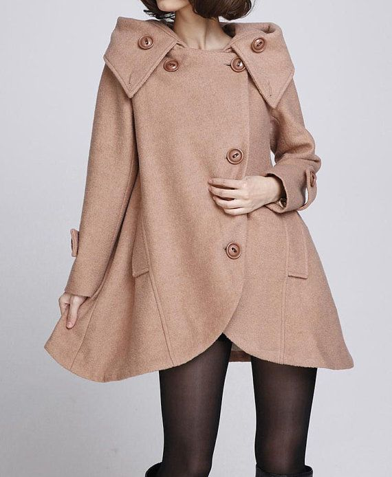 Wool overcoat A font design, hem asymmetric, behind cute doll style, very thick, very warm, very large hat personality can be folded into the collar, the.