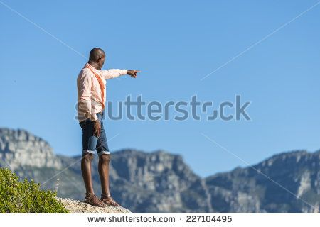 http://www.shutterstock.com/pic-227104495/stock-photo-african-black-man-standing-on-a-high-rock-overlooking-cape-town-as-he-points-and-scouts-the-blue.html?src=WuffEuvvGWj02MQSGcnIHQ-1-8 African Black Man, Standing On A High Rock Overlooking Cape Town As He Points And Scouts The Blue Sky, Ocean And Mountains On A Sunny Summers Day Stock Photo 227104495 : Shutterstock