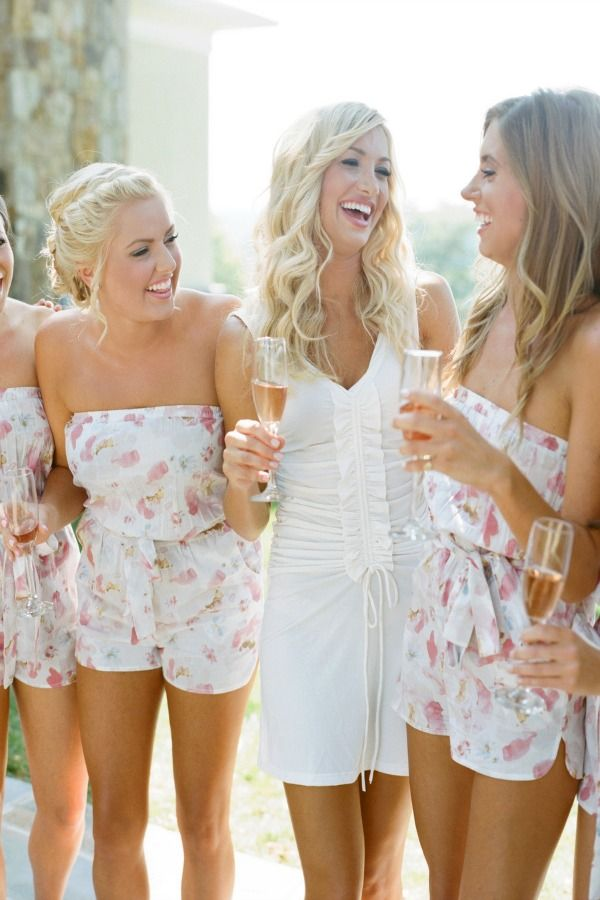 Bride Drinking Rose With Bridesmaids In Plum Pretty Sugar Rompers