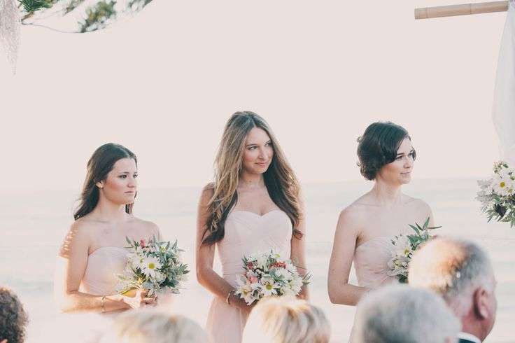 beautiful bridesmaids standing at the wedding ceremony at longreef golf course