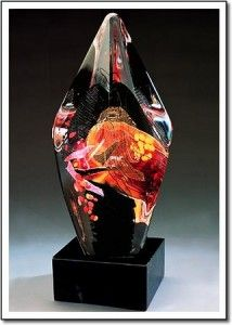 Scarlet Facet Collage.   A black glass central element surrounded by layers of clear and colored glass.