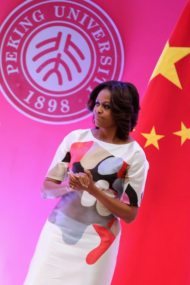A Definitive Ranking Of Michelle Obama's China Tour Style | Moving Art. For a speaking engagement at the Stanford Center at Peking University, Obama slipped into a Carolina Herrera sheath dress with a red, gray, black and tan graphic design. No blending in to the background with such a powerful print....