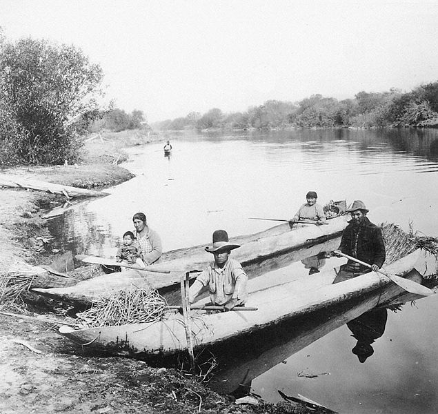 3. Location unknown, between 1870-1900. Klamath people in dugout canoes.