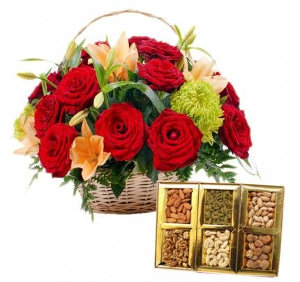 A basket of flowers with Mix Dry Fruits.