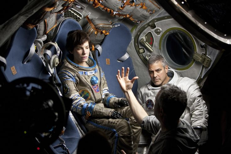 """Alfonso Cuaron directs Sandra Bullock and George Clooney on the set of """"Gravity"""", 2013"""
