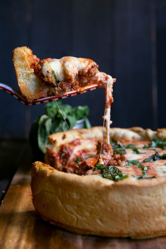 Outrageous AMAZING recipe for DEEP dish pizza with ooey-gooey cheese and a butter-cornmeal crust. MUST MAKE!