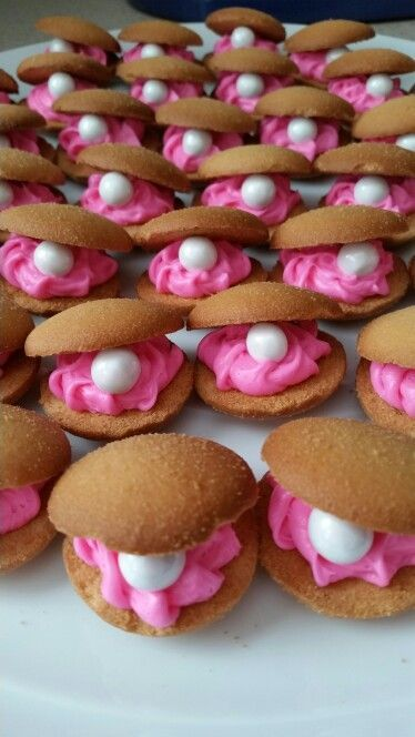 Oyster cookies for my daughter's Bubble Guppies birthday party! Vanilla wafers, store bought hot pink icing, and white Sixlet pearls! Super easy and cute :)