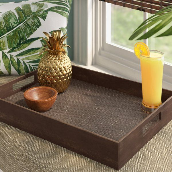Perfect for displaying everything from clusters of candles to piles of vintage books, this tropical serving tray is an excellent addition to entertaining arsenal. Made in the USA from manufactured wood in a selection of painted stains, this tray strikes a rectangular silhouette with clean-lined side walls. A woven PVC insert lines the tray to prevent its contents from sliding, while two cut-out handles make it easy to serve breakfast and coffee in bed or carry drinks to your patio table…