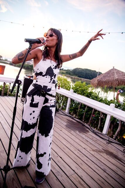 7 Parties, 20 Sunny Looks To Copy Today #refinery29  http://www.refinery29.com/2015/08/92334/summer-day-party-outfit-ideas#slide-3  A cow print (or is it splatter painted?) jumpsuit is the perfect on-stage look for Iconapop playing at The Surf Lodge. ...