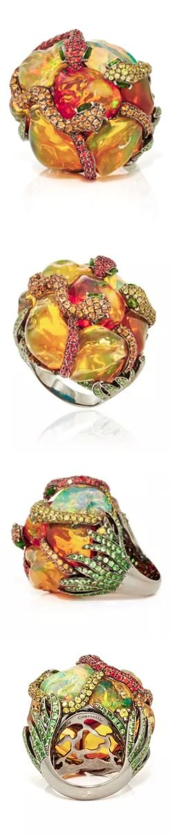 Lydia Courteille, One of a Kind Xochimilco Ring, With an incessant fascination for the beautiful, the strange and the curious, this colorful ring by Lydia Courteille features a floral three dimensional silhouette embellished with opal petals finished with contrasting sapphires, green garnets and diopsides. (=)