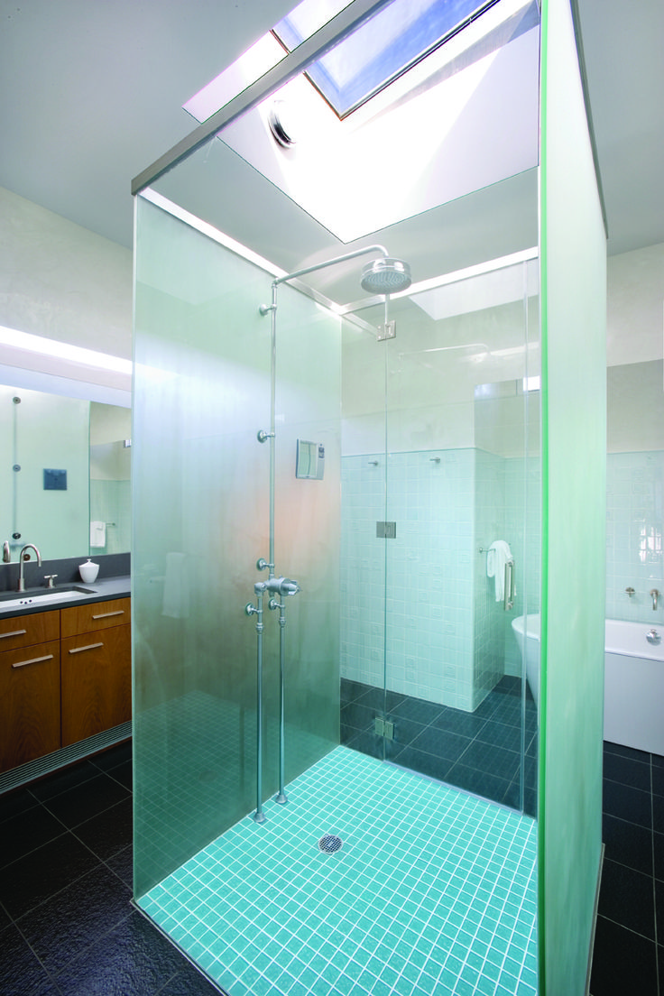 The skylight In the master bathroom highlights the interplay between interior and exterior space.