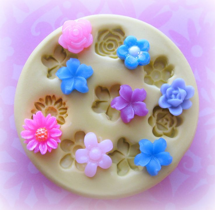 Tiny Flower Mold Daisy Rose Mold Flower Silicone Flexible Clay Resin Mould. $8.95, via Etsy.