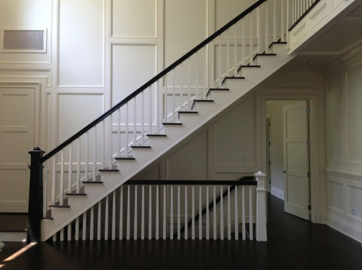 open staircase to basement and floor to ceiling wainscoting