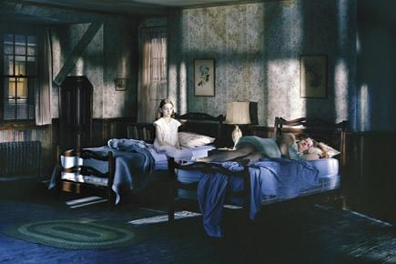 gregory crewdson - interested in the underlying blue shadows and the cold white light that pierces the room.  Interesting play of shadows.