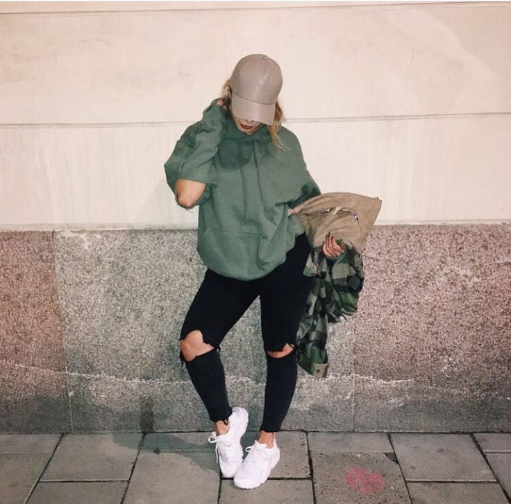 Leather baseball cap, olive pullover hoodie, black ripped jeans, Nike's  sneakers, camo jacket