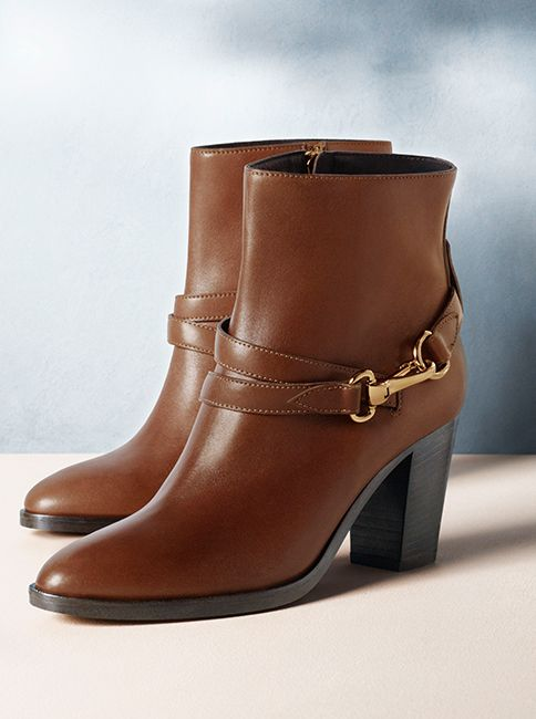 Leather ankle boots with heritage-inspired buckles from Burberry for S/S14