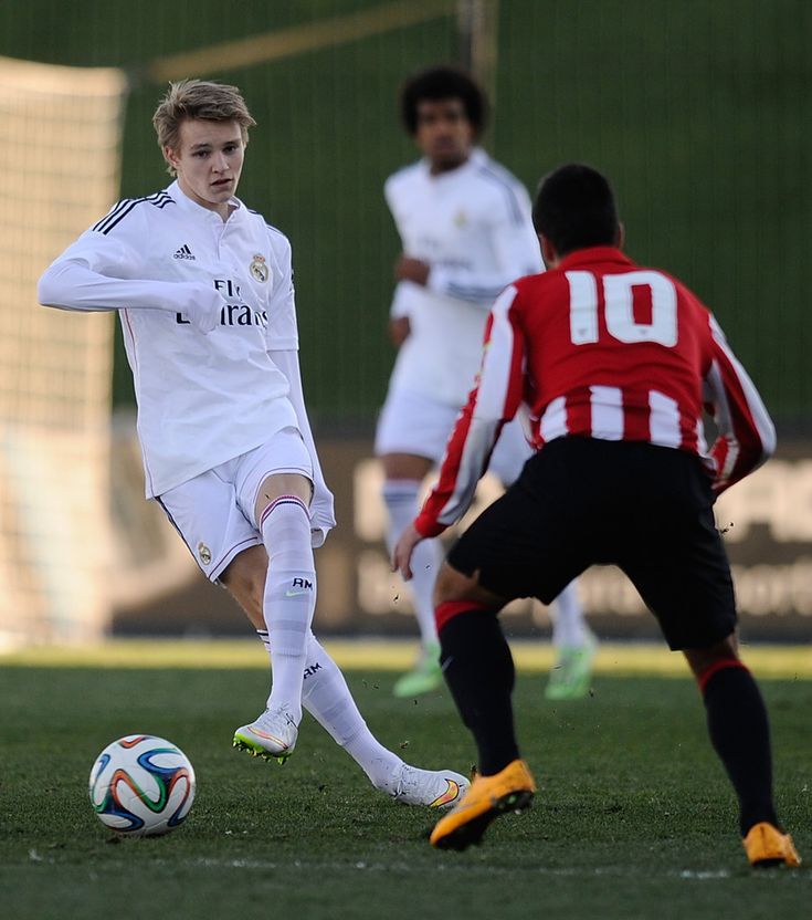 Martin Odegaard of Real Madrid Castilla in action against Martin Bengoa of Athletic Club B during the Segunda Division B match between Real Madrid Castilla and Athletic Club B at Estadio Alfredo Di Stefano on February 8, 2015 in Madrid, Spain.