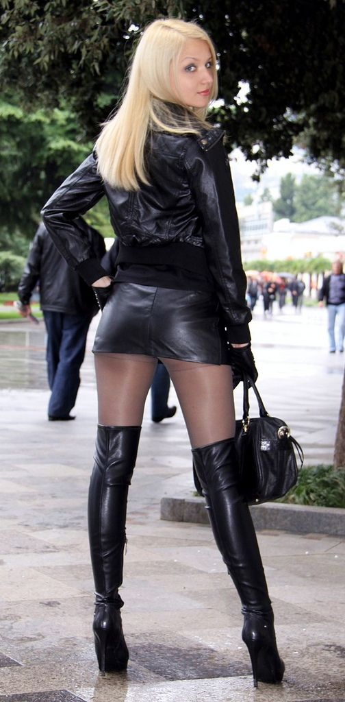 Sexy woman in very sexy short leather mini with thigh highs! More sexy women at http://www.sexy-calendars.net