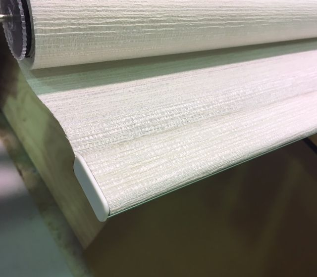 within the 'homebrand plus' range of roller blinds this bottom rail option is available at an extra $18.6+gst per metre of bottom rail – this is the 'Louvolite Easy Fit' bottom rail option – talk to ryan at blindsonline.net.nz for your next quote