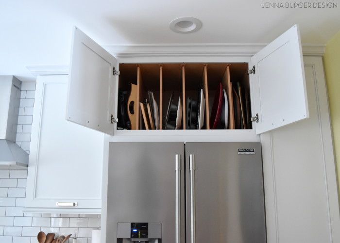 Full Depth Cabinet Above The Refrigerator With Vertical Dividers Perfect For Trays Cookies