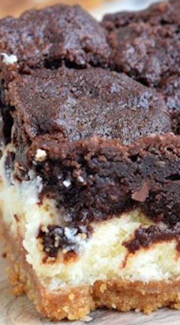 Chocolate Cheesecake Bars ~ It starts with a graham cracker crust. Then it's topped with a creamy vanilla cheesecake. And topped with chocolate cookie dough... All baked to perfection.