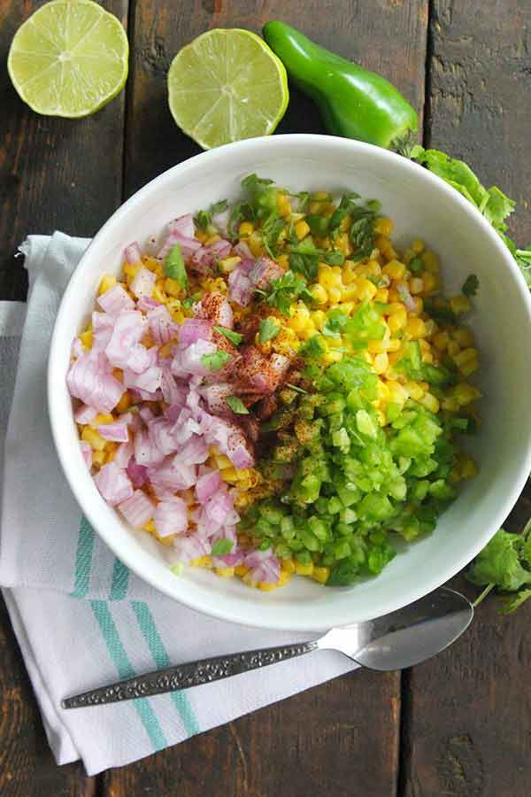 A really easy way to recreate Chipotle Mexican Grill corn salsa at home. This recipe is INSANELY easy, it's only 2 simple steps, stay in tonight and try it!