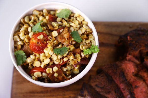 Michael Symon's Corn Succotash-   ingredients      1/2 pound Bacon (small dice)     4 ears fresh Corn (cut off cob)     1 pint Cherry Tomatoes (halved)     1/2 bunch Cilantro (picked)     zest of 1 Lime     Salt and freshly ground Pepper