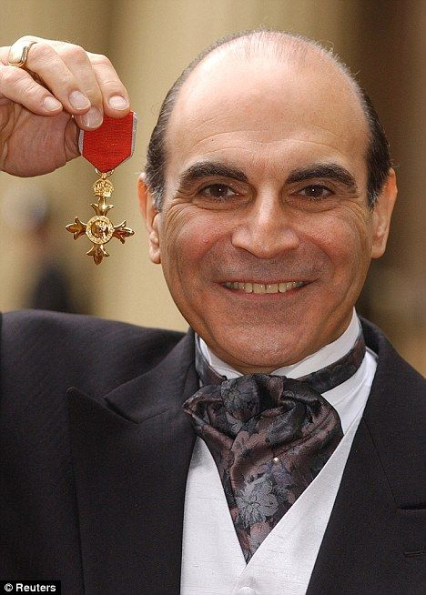 David Suchet was presented with his CBE at Buckingham Palace in 2002 by the Queen, who stated during the ceremony that she was a fan of Hercule Poirot